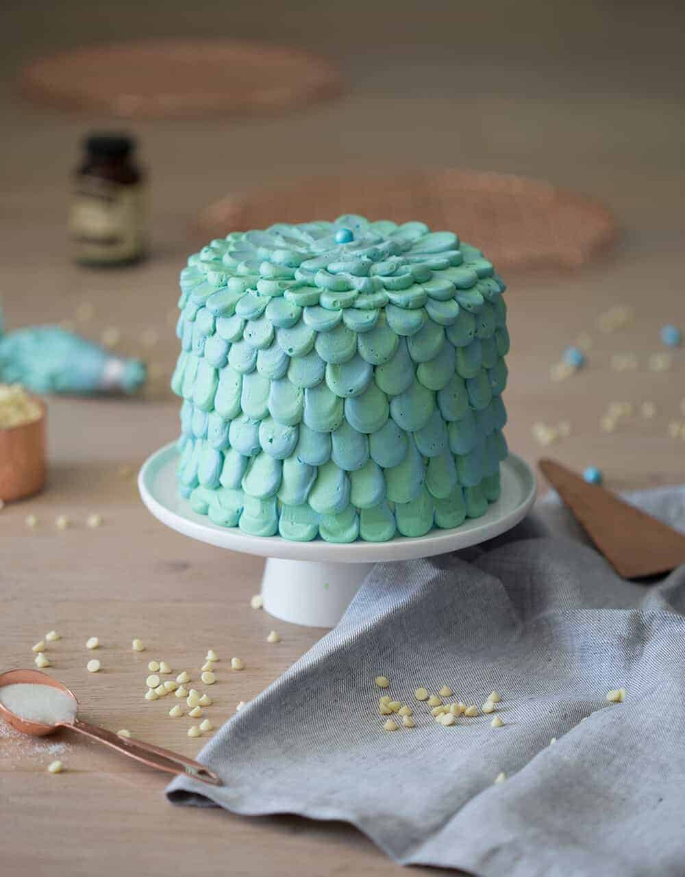 a photo of a mermaid cake on a cake stand.
