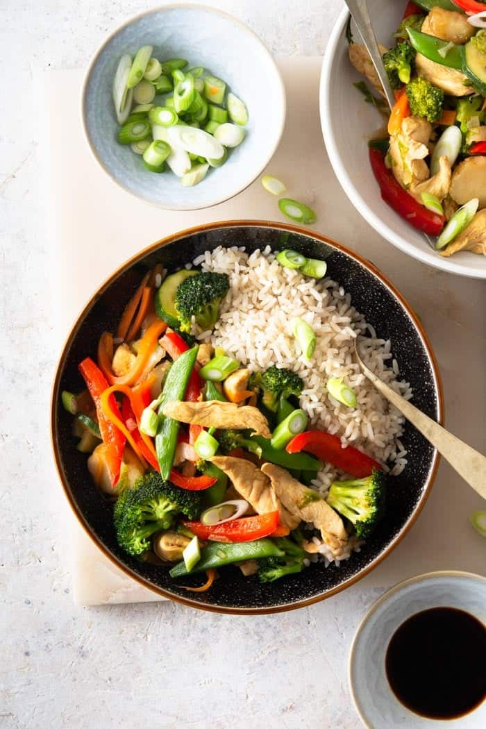 A top down shot of chicken vegetable stir fry.