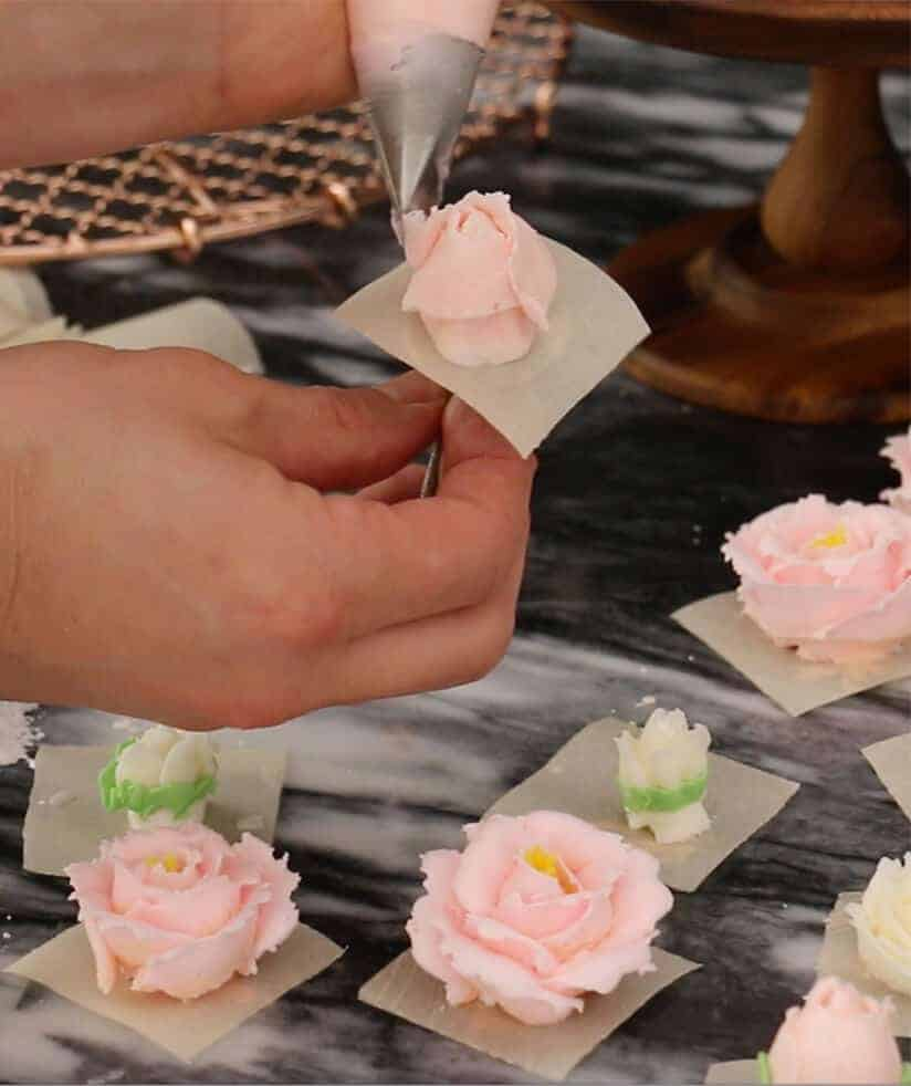 A process shot of flower being made out of vanilla buttercream.