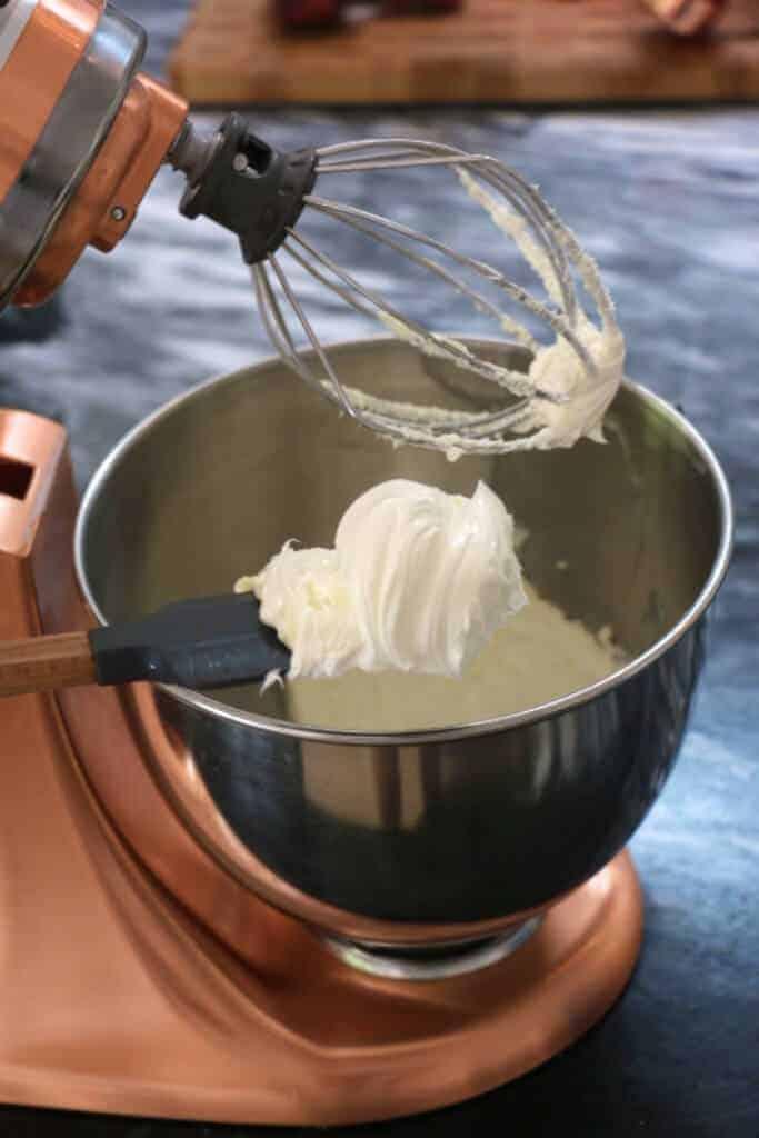 A process shot of vanilla buttercream being made.
