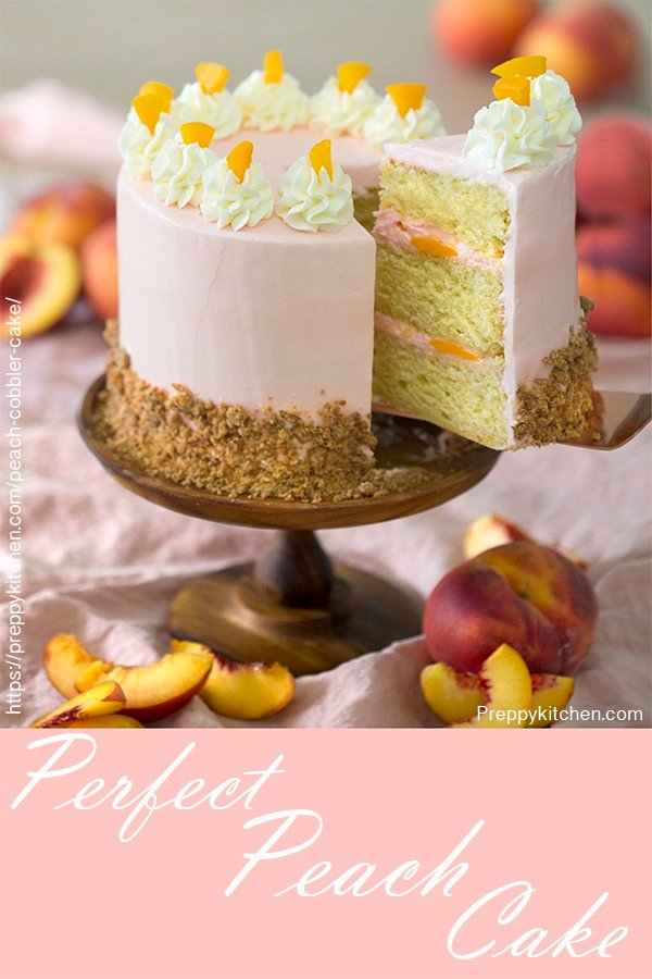 This moist peach cake made with fresh peach purée, covered in creamy Swiss buttercream and a crunchy cobbler crumble is a MUST MAKE cake. It's really just peachy.