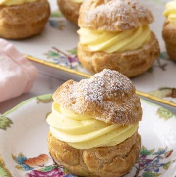 Cream puffs with a big swirl of vanilla pastry cream inside.