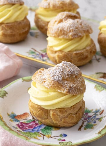 Cream puffs with a big swirl of vanilla pastry cream inside.
