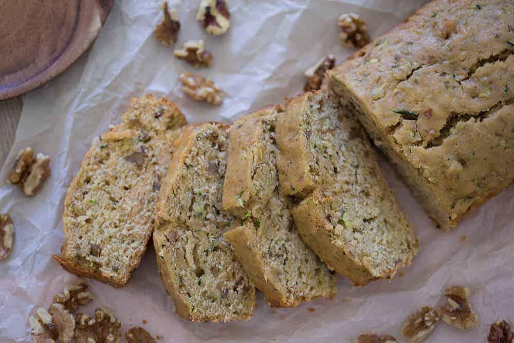 A photo of maple walnut zucchini bread cut into slices.