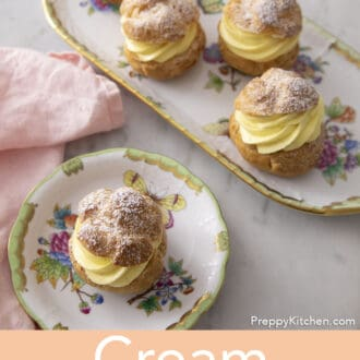 Cream muffs on a plate.