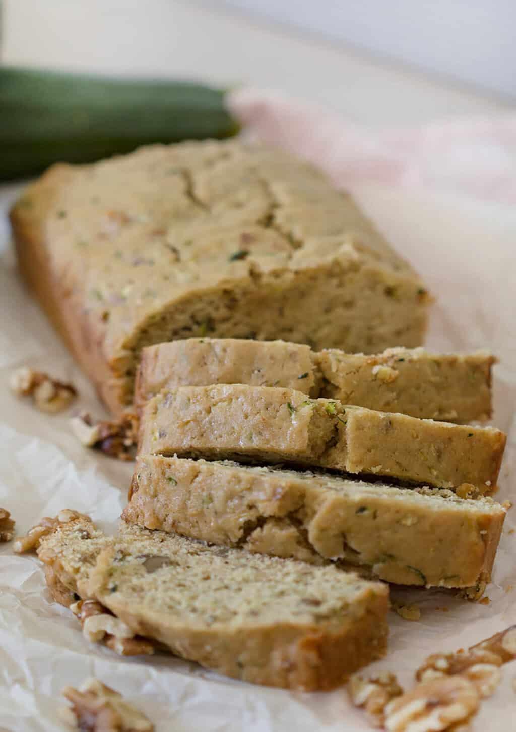 Maple Walnut Zucchini Bread cut into slices.