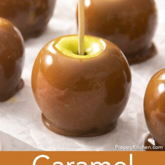 Caramel apples on parchment paper.
