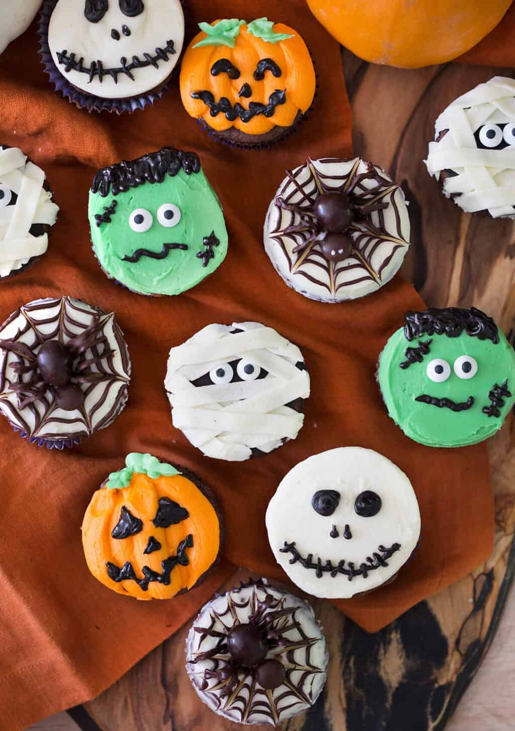 photo of different types of Halloween Cupcakes on a wooden background