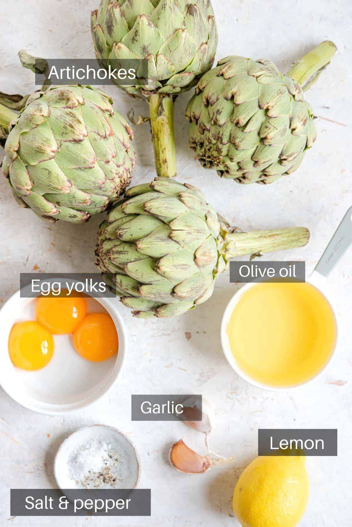 An overhead shot of all the ingredients you need to make roasted artichokes