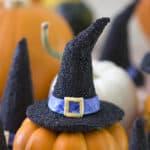 A witch hat cookie pm a mini pumpkin