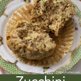 Zucchini muffin split in half on a plate