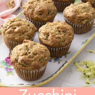 seven Zucchini muffins on a tray
