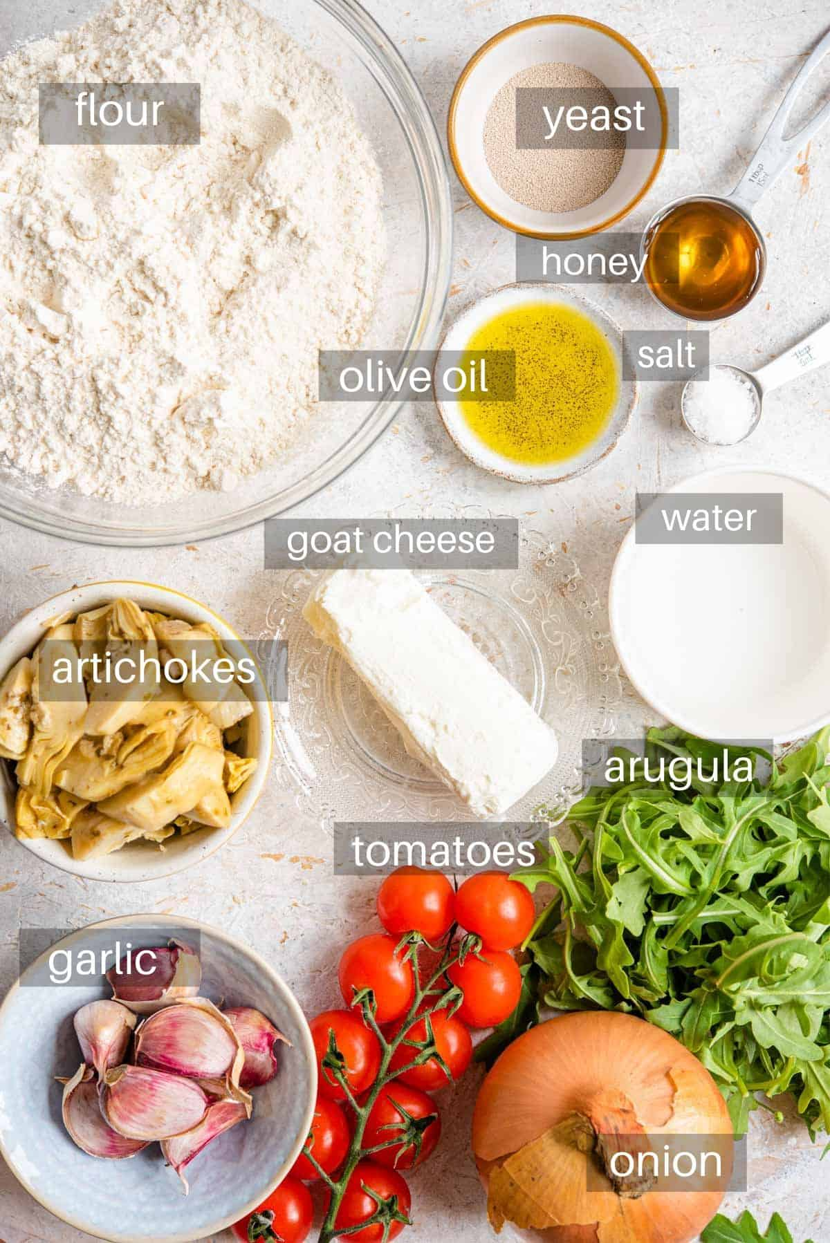 An overhead shot of ingredients you need to make artichoke pizza