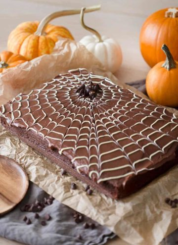 A photo of a chocolate spider web cake with a chocolate spider on top.