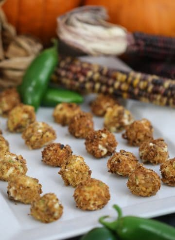 A photo showing a place of fried cheese balls with autumnal elements in the background.