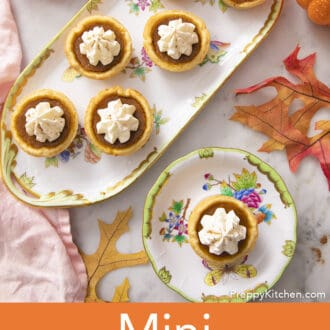 Seven mini pumpkin pies with whipped cream.