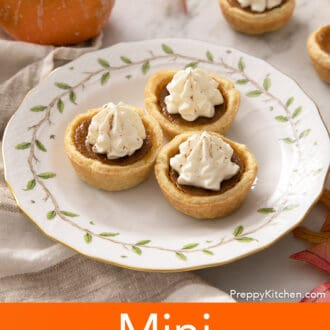 Three mini pumpkin pies on a porcelain plate.