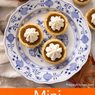 Three mini pumpkin pies on a blue and white plate.