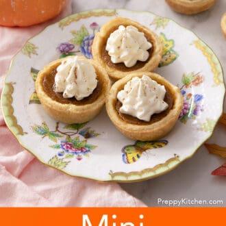 Three mini pumpkin pies on a small plate.