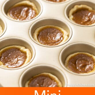 Freshly baked Mini pumpkin pies in a baking tin.