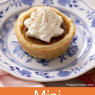 A mini pumpkin pie on a blue and white plate.