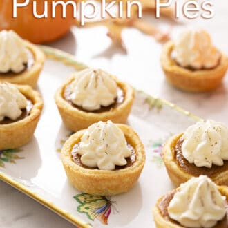 Mini pumpkin pies on a marble counter.