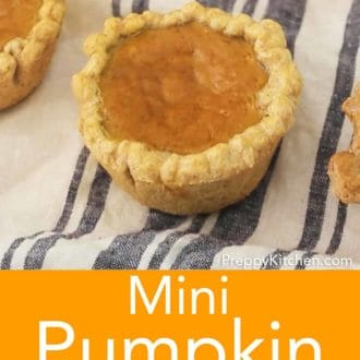 mini pumpkin pie on a striped linen napkin