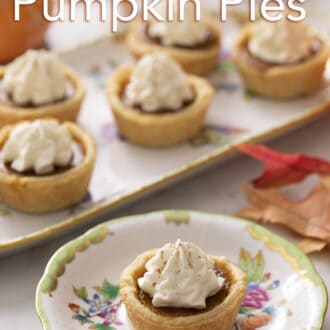 Mini pumpkin pies topped with whipped cream.