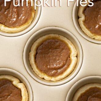 Mini pumpkin pies in a golden baking pan.