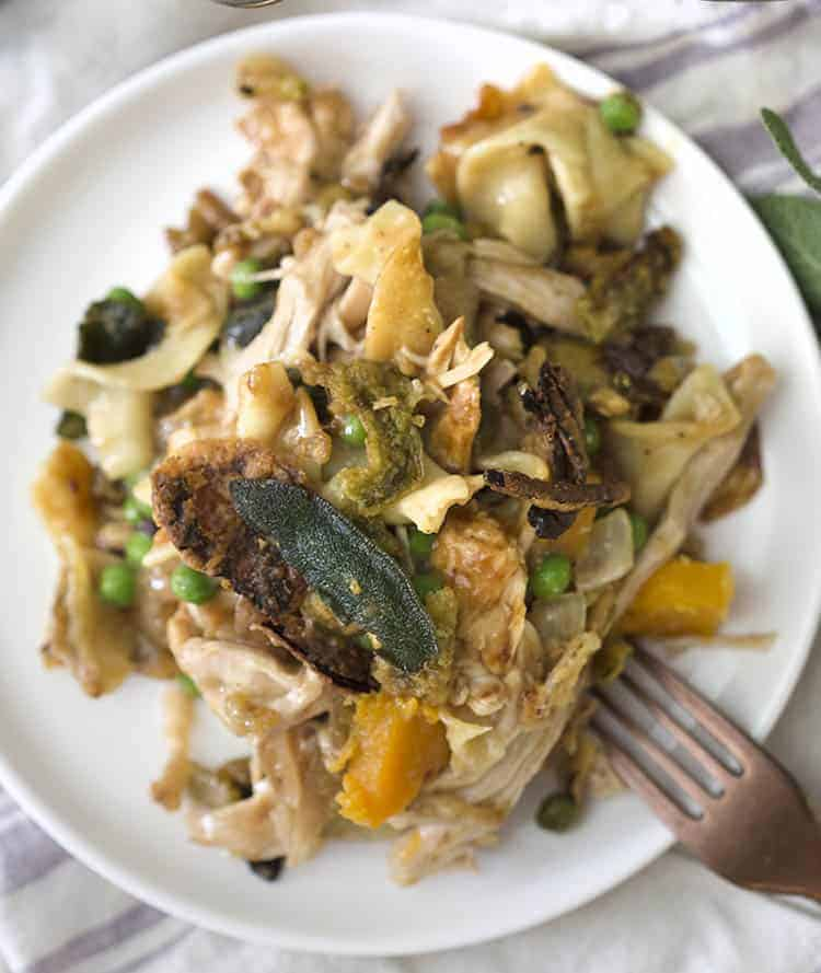 A plate of turkey casserole with sweet potatoes, peas and onions