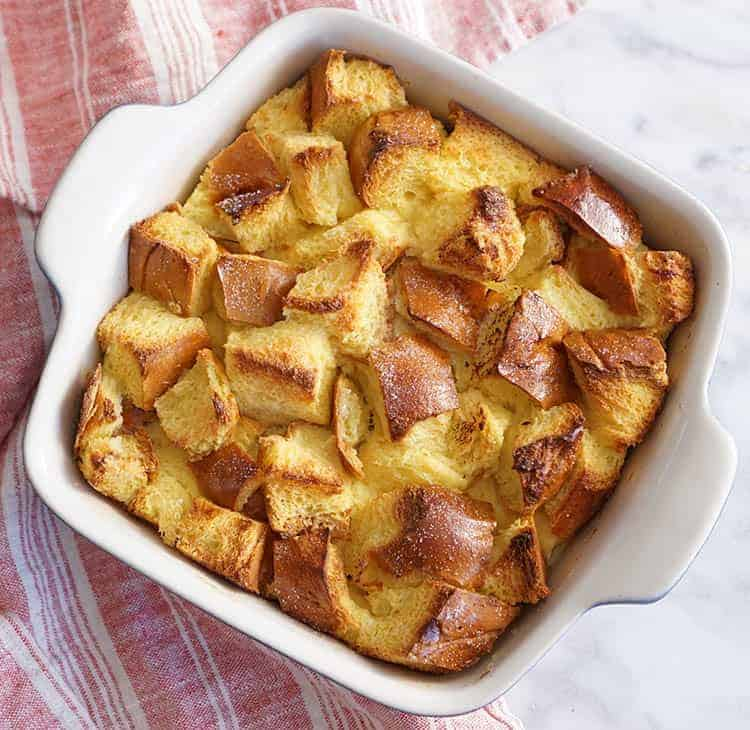 A dish of bread pudding after being baked.