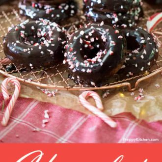 A clipping of chocolate peppermint donuts in a pile.