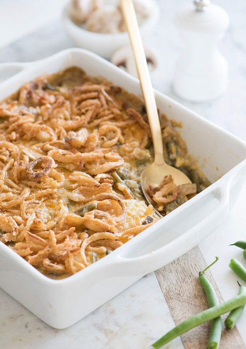 Photo of a green bean casserole in a white serving dish