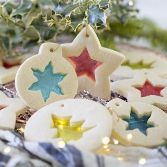 A photo of stained glass cookies hung as ornaments on holy