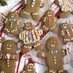 gingerbread men decorated with royal icing on a copper cooling rack.