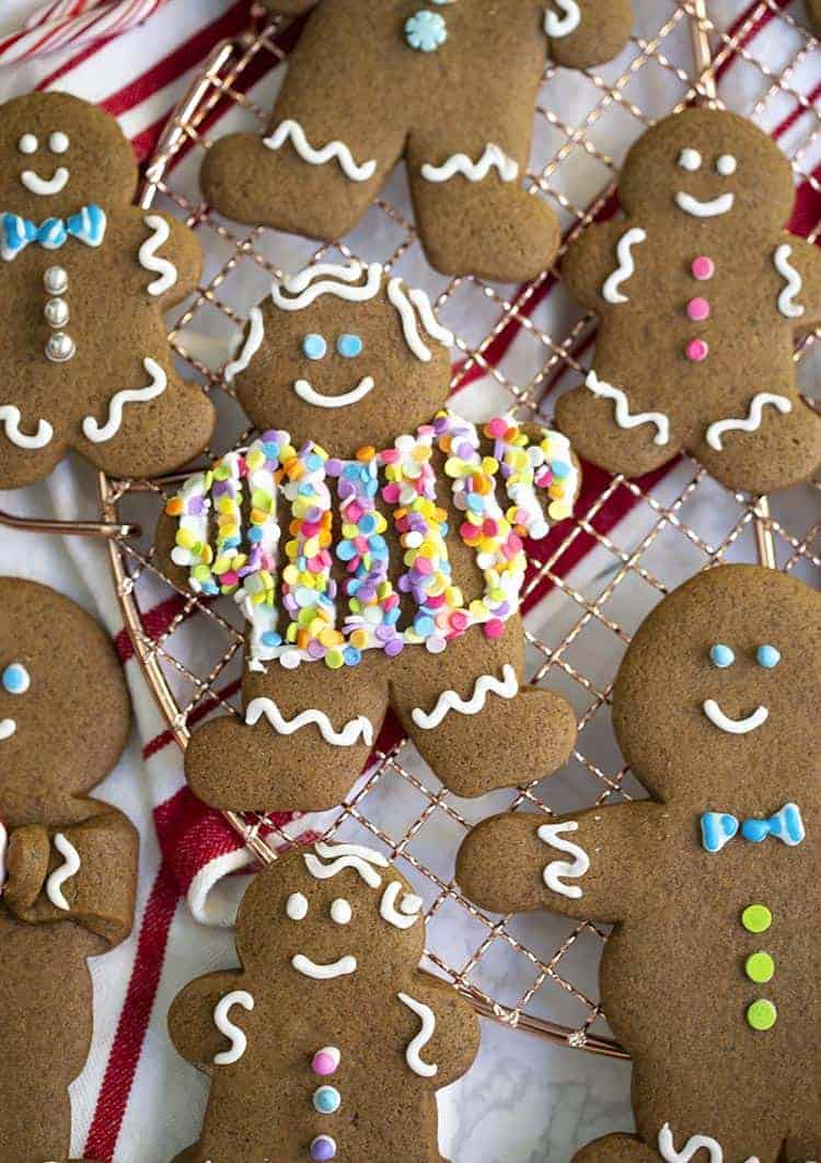 various gingerbread cookies decorated with icing and sprinkles.