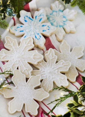 A photo of snowflake cookies in a pile.