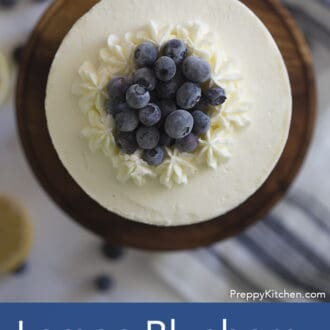 top of three layered lemon blueberry cake with white frosting
