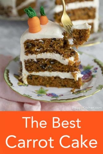 A piece of carrot cake being eaten with a gold fork.