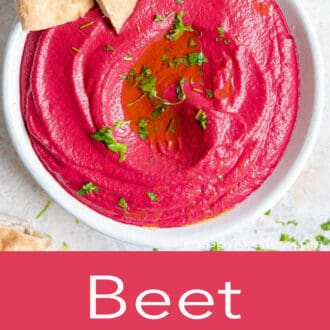 beet hummus in a white bowl