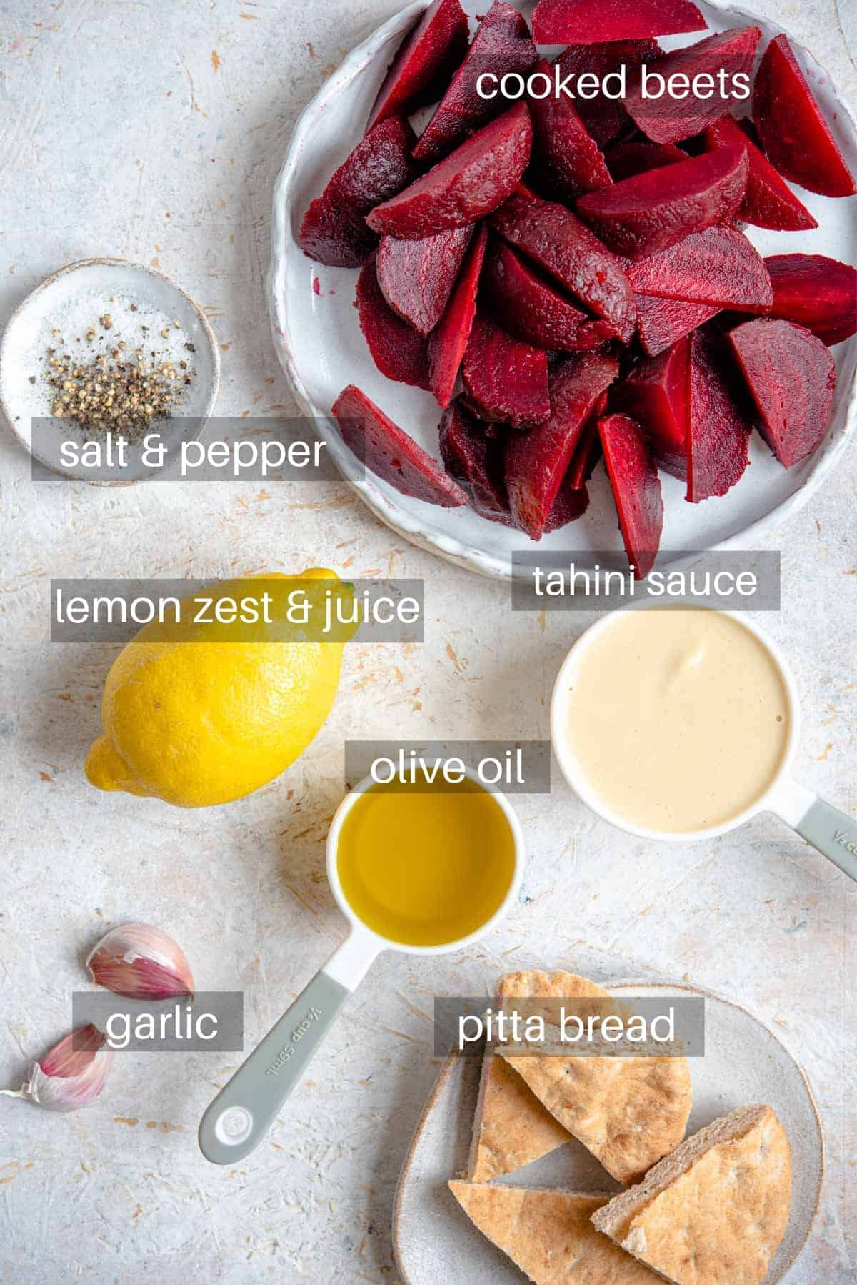AN overhead shot of ingredients needed to make hummus with beets