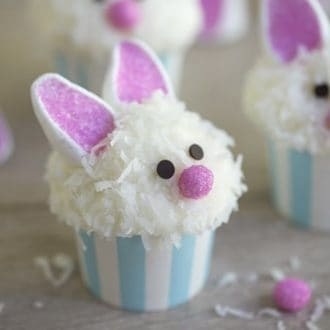 A photo of a bunny ear cupcake with a pink nose