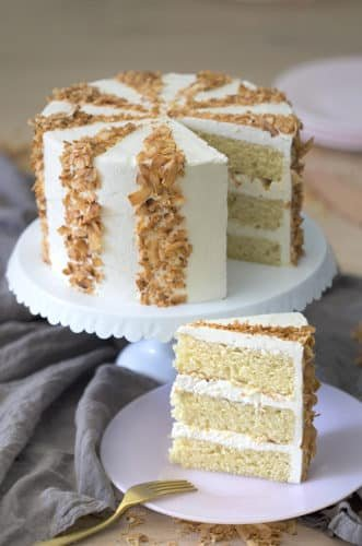 photo of a cocobut cake with toasted coconut flake stripes.