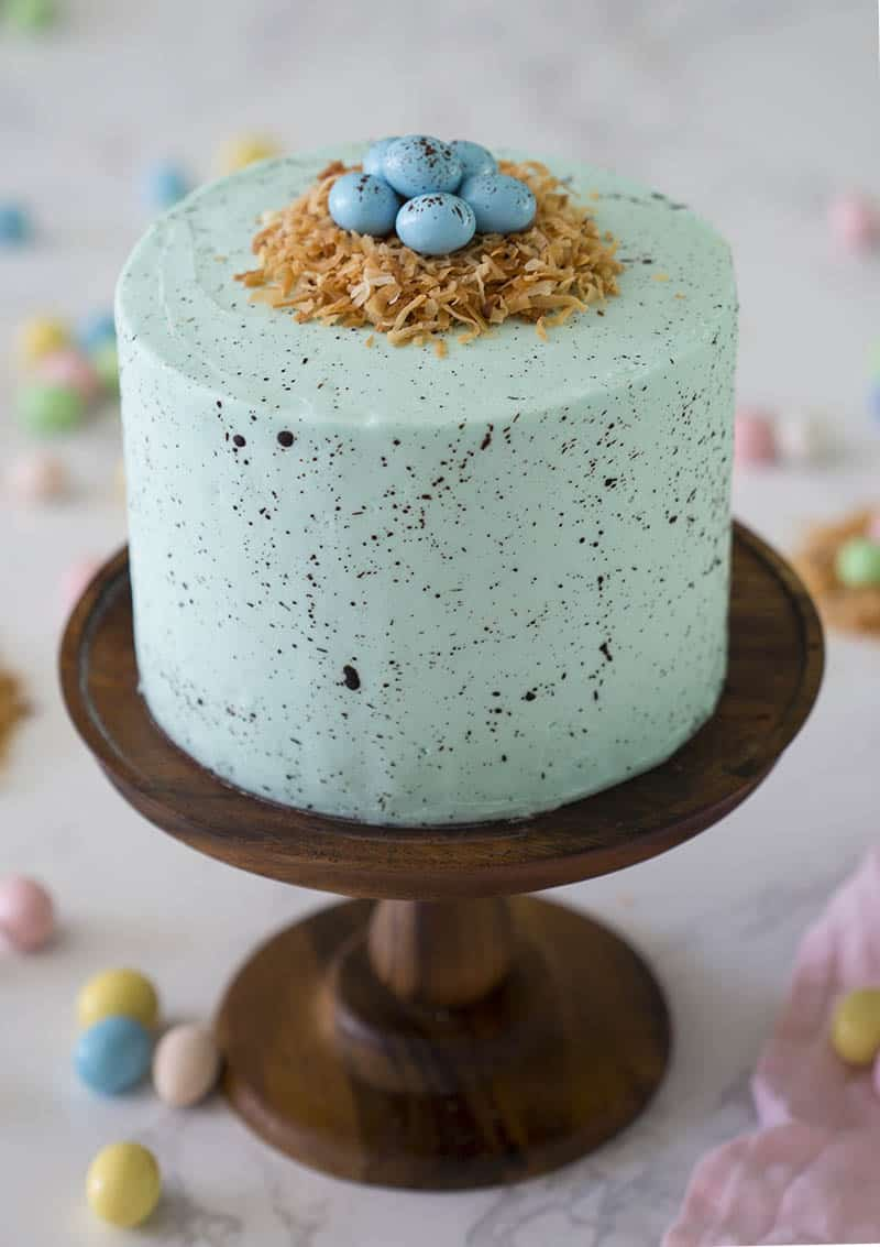 An Easter egg cake topped with a coconut nest.