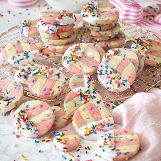 photo of pink and white Funfetti Cookies on a copper wire rack.