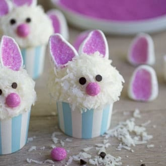 Easter bunny cupcakes with marshmallow ears and coconut fur.