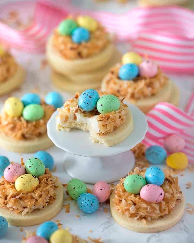 a goup of bird nest easter cookies one with a bite out