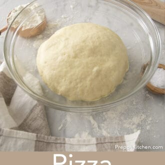 Pizza dough rising in a bowl.