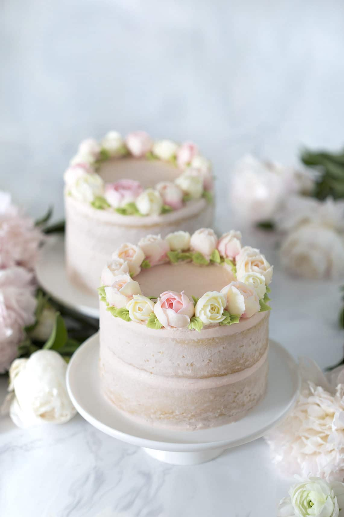 photo of two Smash Cakes on a table with flowers