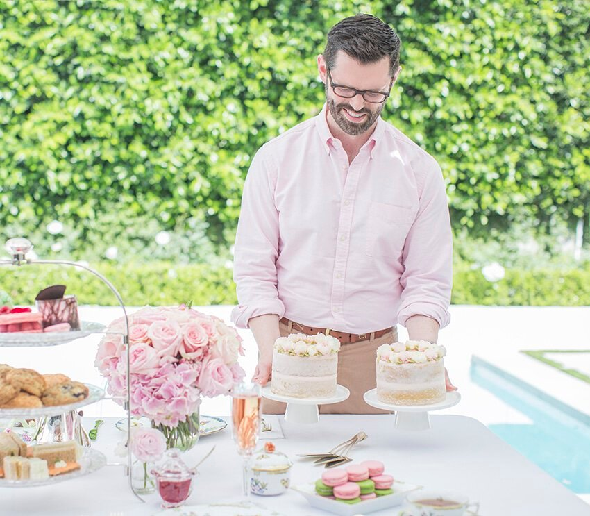 Photo of John placing cakes on table